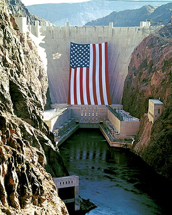 Hoover Dam with usa's flag
