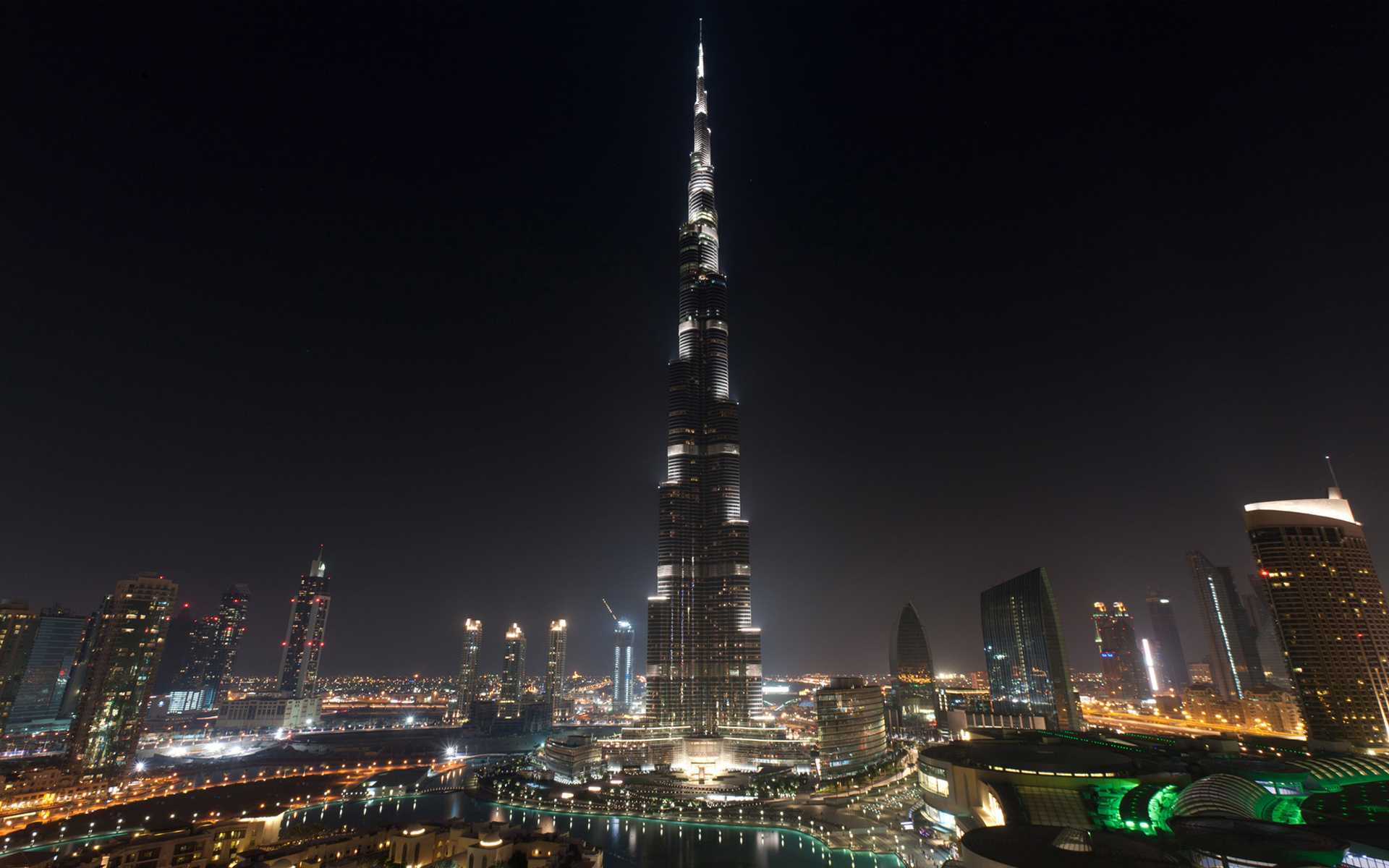 burj khalifa at night with other buildings