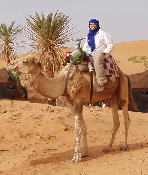 This guy is ready for a camel ride adventure on the Sahara Desert