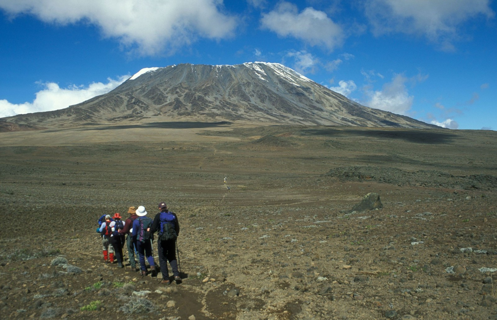 group-of-walkers-heading-for-the-snow-capped-mount-kilimanjaro-tanzania-africa-1600×1031